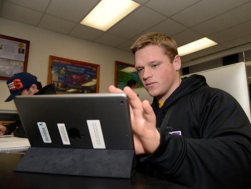 student accessing iPad