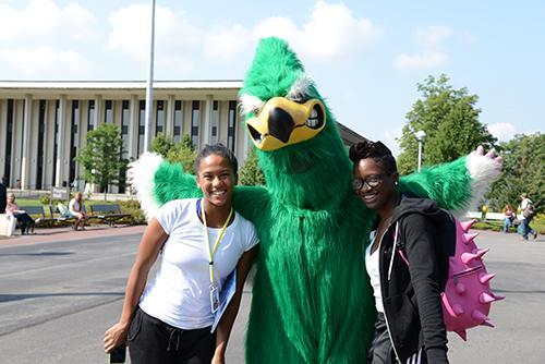 Moe posing with 2 students