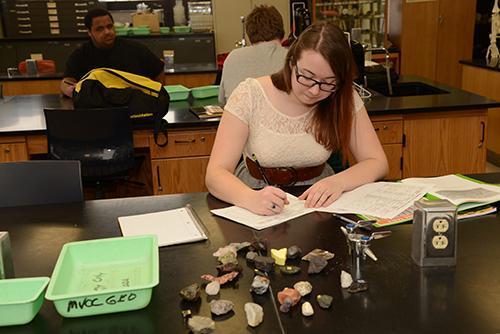 student categorizing rocks