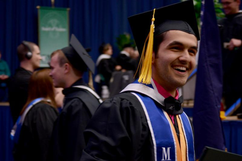 Student in cap and gown at graduation