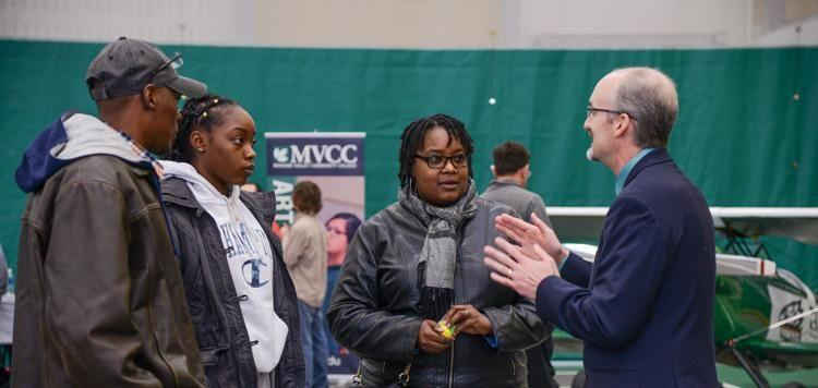 MVCC president talks to visitors at Open House