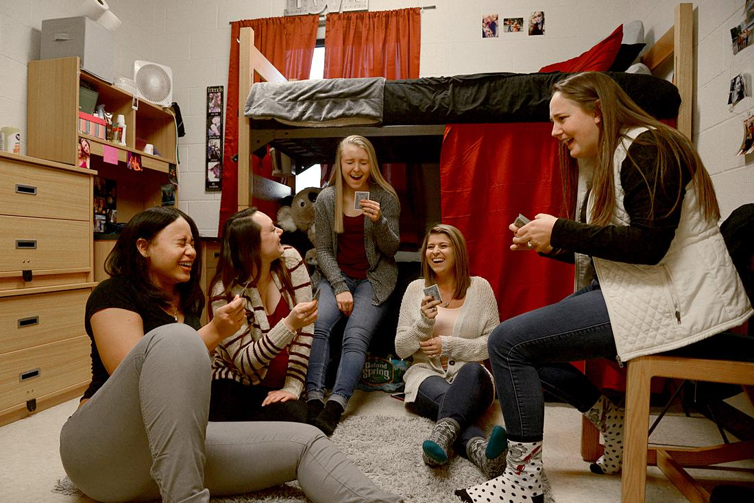 Group of students laughing in dorm room