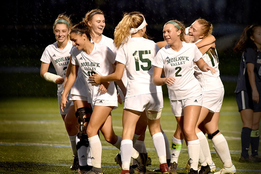 MVCC Women's soccer team players celebrate a victory