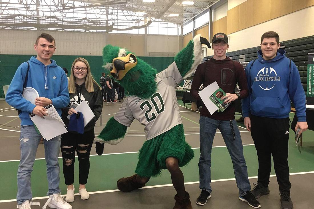 MVCC mascot Mo Hawk with students at Open House