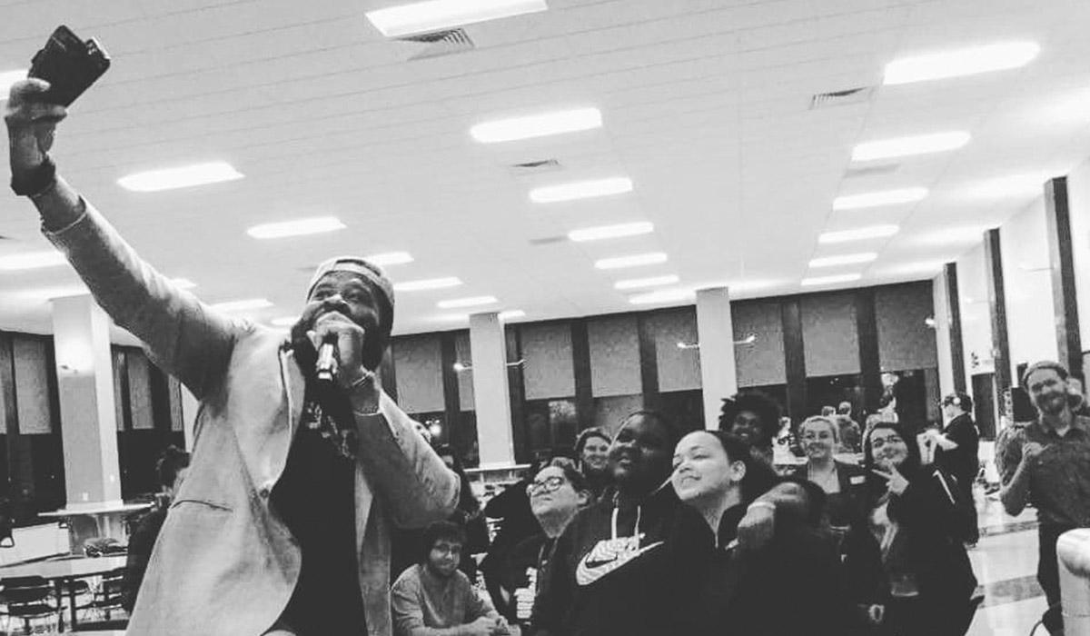 Program Board Comedian taking a selfie with MVCC Students