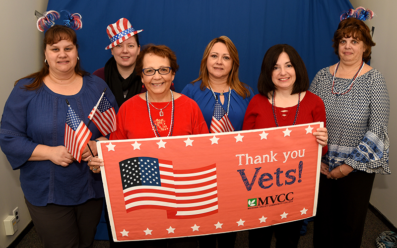 MVCC staff holding Thank You Vets sign