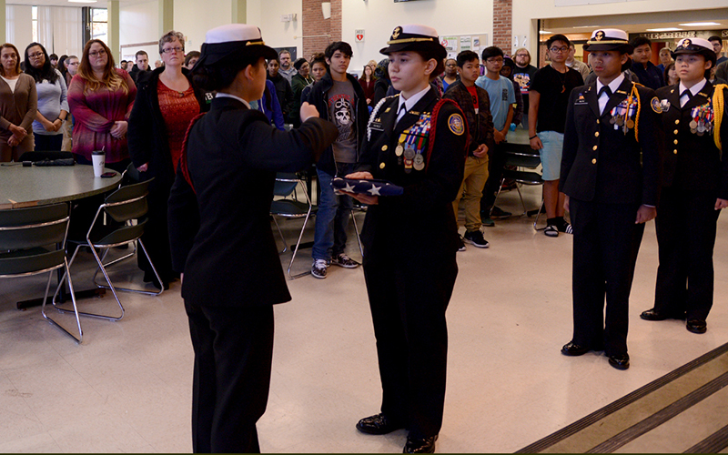 NJROTC students pass flag