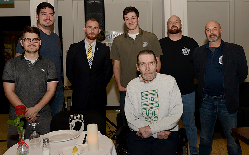 student veterans pose for a photo with community member veteran