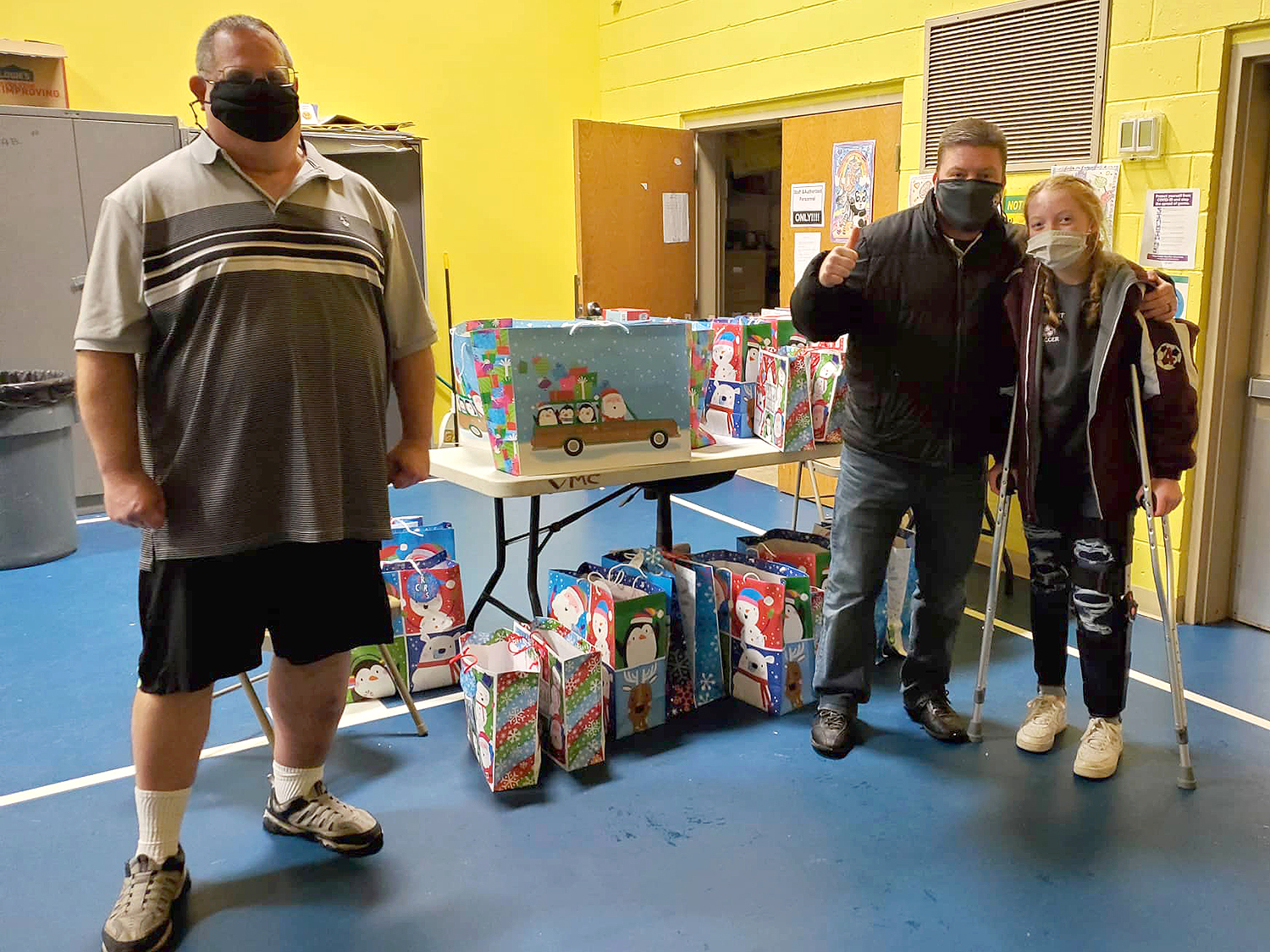 Kidz N Coaches delivered the wrapped gifts to the apartment building where the children live.