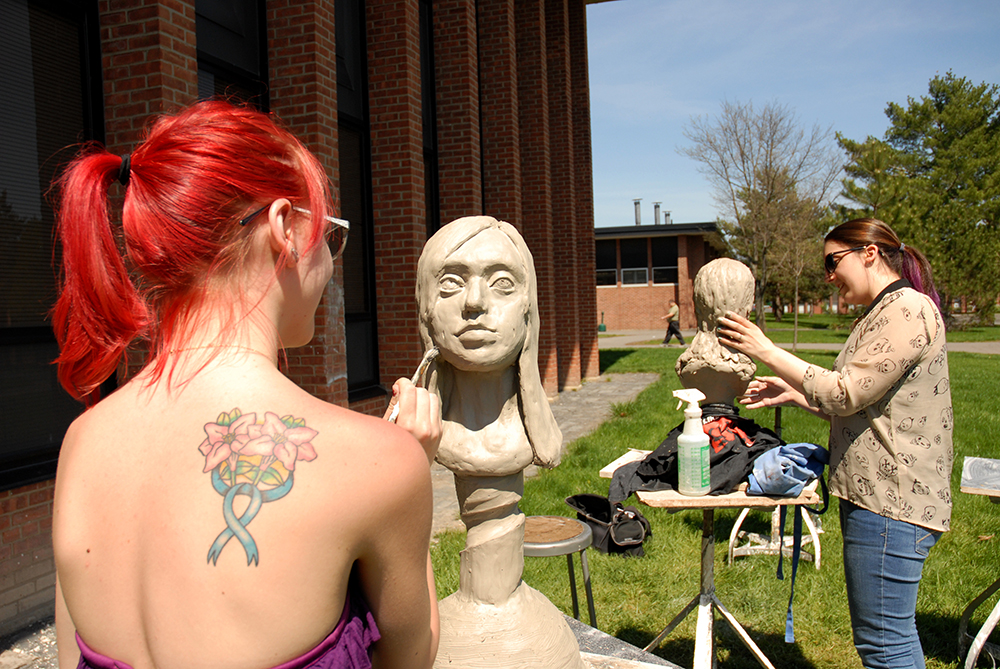 Sculpture students working outdoors